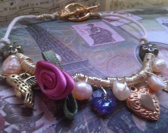 Charmed Bracelet- with Gold tone Hummingbird & Heart Charms, Swarovski Crystal and Silk Rose
