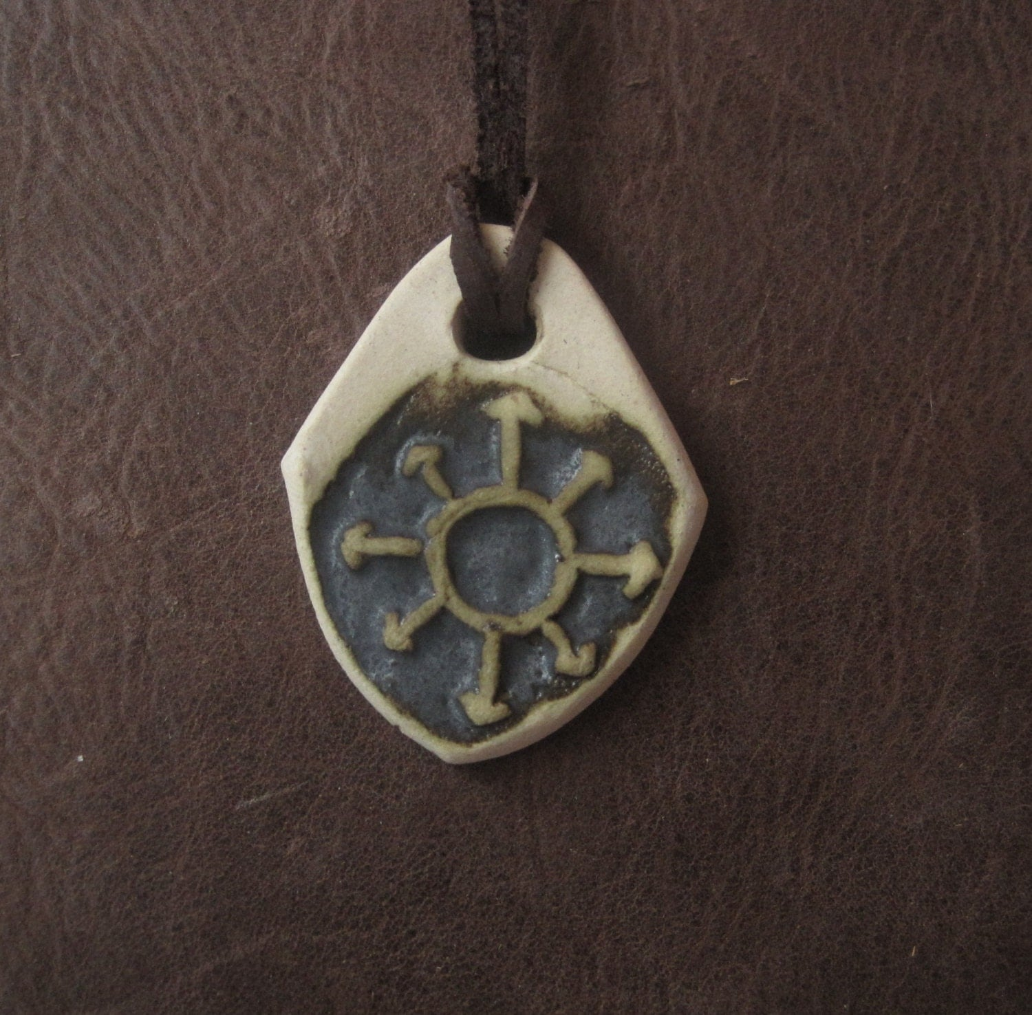 pendant with the symbol of chaos chaos by vlodarius