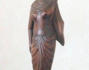 A handmade wooden sculptures purchased in the early 60 'in India