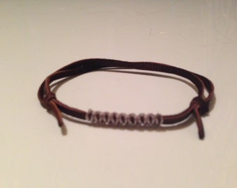 Simple leather knotted bracelet with cord detail