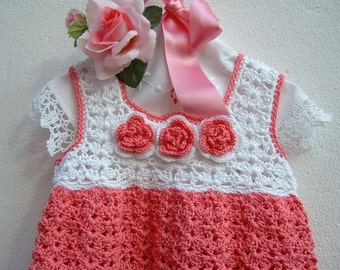 Hand crocheted baby dress in pink and white cotton. Crochet baby girl, romantic and feminine fashion. To order.