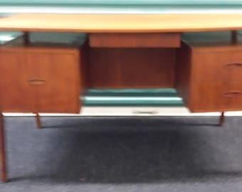 "Danish ""walking leg"" floating top desk in teak, 1950's"