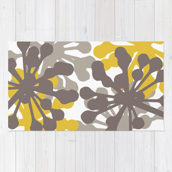 details floral rug brown and mustard yellow area