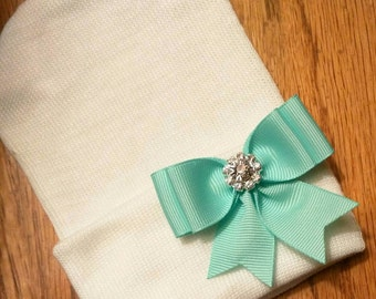 Newborn Hospital Hat w/Mint Green Bow with Rhinestone on it 1st Keepsake. White Hat. Super cute and Beautiful For Your Newborn!