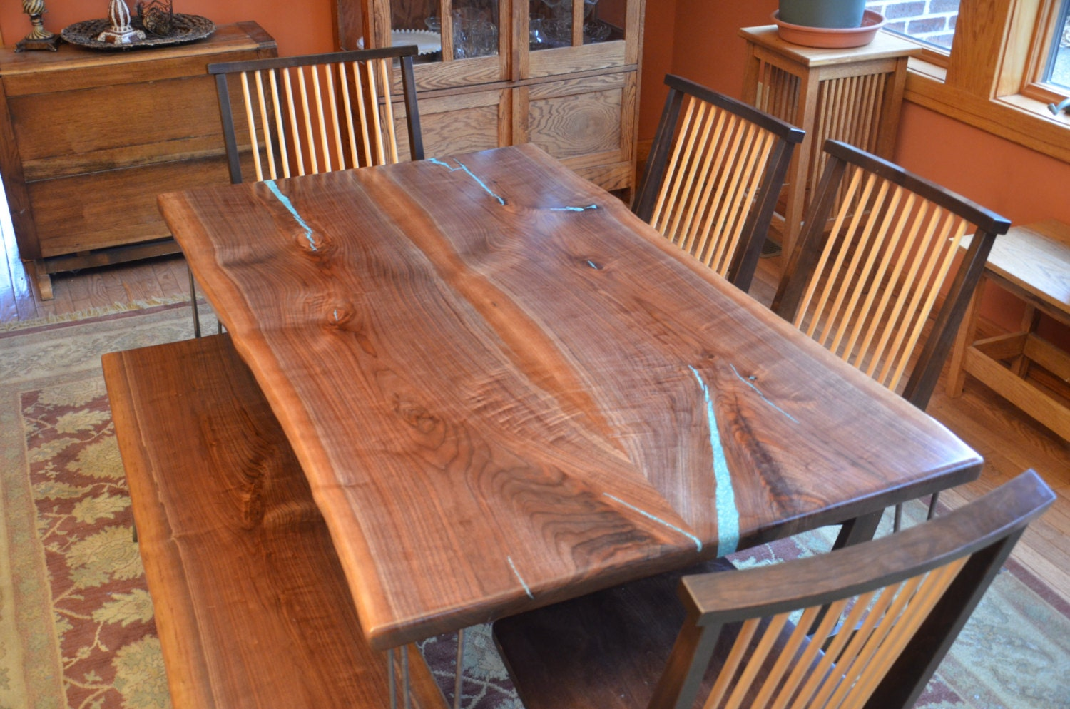 bookmatched black walnut dining room table with turquoise
