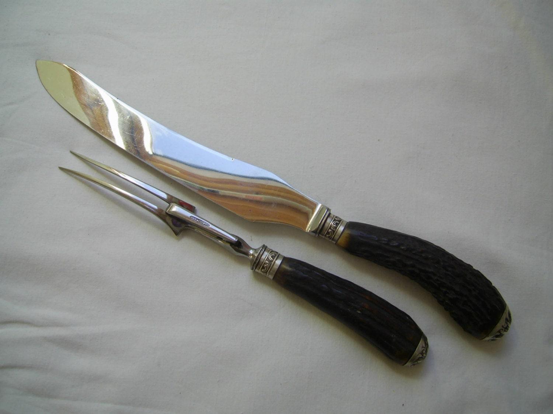 Good quality vintage horn handled carving knife and fork
