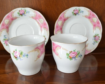 Teacups and Saucers in Pink and White