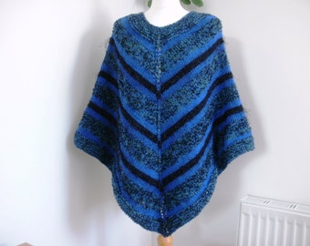 Women's knitted poncho, blue green black poncho, multi coloured poncho, winter wrap, multi fit, textured chunky yarn, unique design, gift.