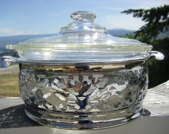 "Vintage Glasbake Clear Casserole with Lid in Silver-tone Serving Holder, 7-1/4"" diameter"