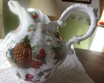 """Jug in bone china, decorated with fruit, 8"""" 20cms tall, Staffordshire bone china, transfer printed, all kinds of fruit"""
