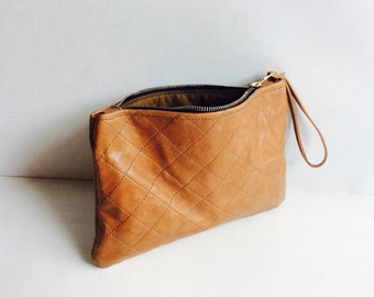Quilted tan cow leather clutch