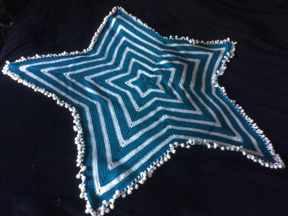 Crochet star afghan with pom pom edging