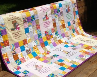 Handmade baby or young child patchwork nursery rhyme quilt.  Features six machine embroidered nursery rhymes.