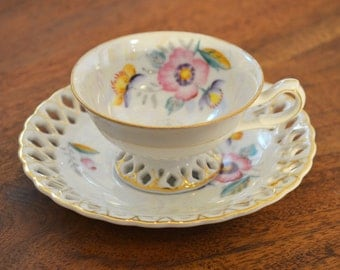 Trimont teacup Occupied Japan. Hand-painted - Opal lustre iridescent with gold trim, reticulated saucer
