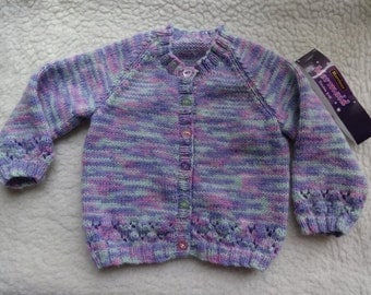 Girls Jacket Cardigan Size 23 inch chest approx 1 to 2 years. Hand knitted in Multi colour DK yarn.