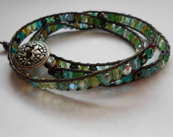 Beautiful brown leather wrap bracelet with Czech glass beads in shades of green and blue.