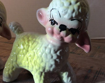 Pair of adorable yellow ceramic lambs