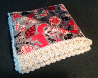 Crocheted baby blanket with fabric back