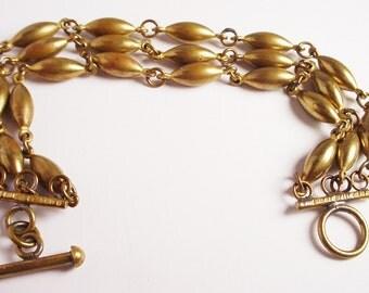 Brass Barrel Shaped Bead Bracelet Triple Strand