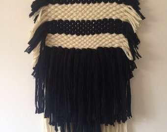 Hand woven striped wall hanging