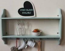 Two tier shelving unit with 7 Shakers pegs
