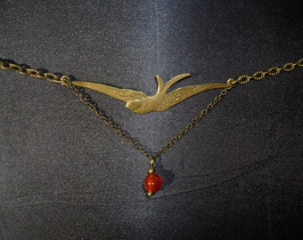 swallow and carnelian pendant