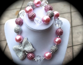 Silver Bow children's Bubblegum Necklace with pink, clear and silver beads.