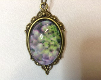 Feelin Brassy! Antique brass pendant with violet  hydrengeas  under glass