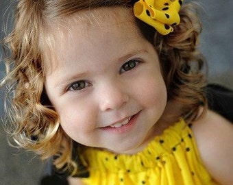 Yellow  bow with Black polka dots