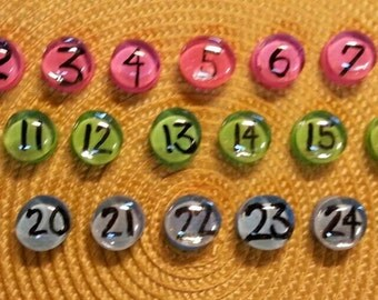 hand-painted pebble number magnets.