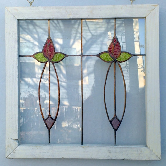 pretty handmade stained glass window with flowers by