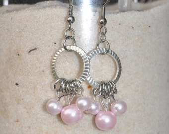 silver and pink dangles