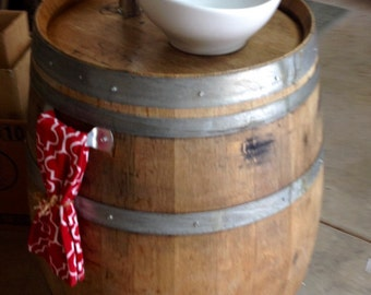 Wine barrel vessel sink vanity.