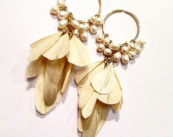 Earing Feathers and Pearls