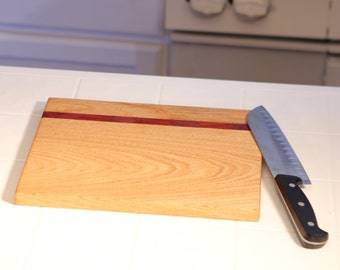 Handcrafted hardwood cutting board made from reclaimed wood. Item #5
