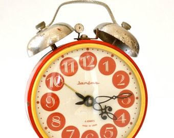 "Red vintage alarm clock ""Jantar"" from the Soviet Union"