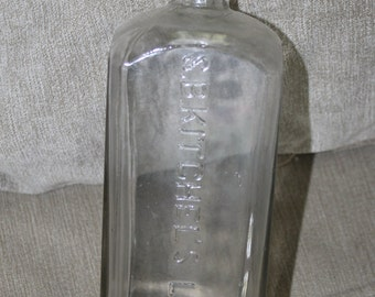 This Bottle is a S B Kitchels Liniment, a liquid or lotion, especially one made with oil, for rubbing on the body to relieve pain Bottle