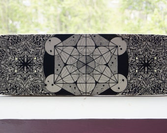 Hand drawn sacred geometry artwork skateboard deck with black and white pointilist / dotwork mandala and Metatrons Cube