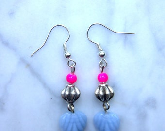 Bright earrings with neon pink and silver bead and a light blue petal