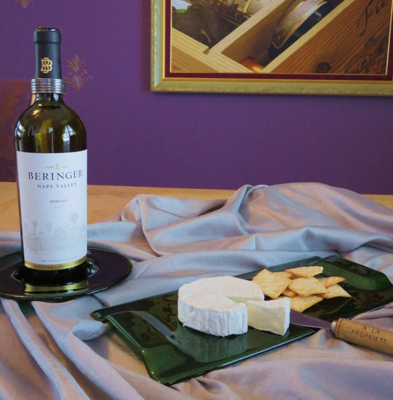 Art glass wine and cheese serving set with wine bottle coaster and serving tray in sparkling aventurine green glass
