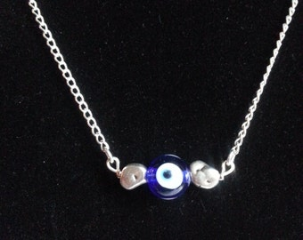 Handmade evil eye and sterling silver pebble necklace