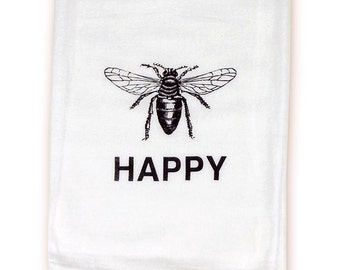 Flour sack kitchen towel, hand silk-screened with the message Bee Happy! Made in Chicago with the help of two cats.
