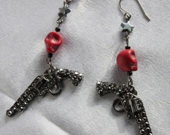 Rhinestone gun earrings with red skulls and hematite stars