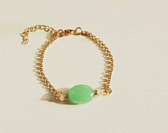 Jasseron bracelet with green/blue faceted bead