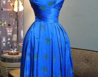 1950s Vibrant Bombshell Blue Dress by Melbray