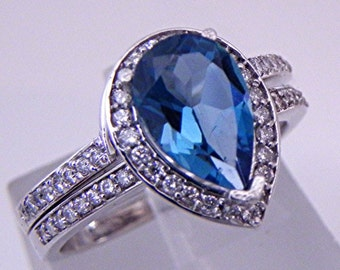 AAAA London Blue Topaz   1.49 Carats   in 14K White gold Bridal set .40cts of diamonds. 1611 MMMM