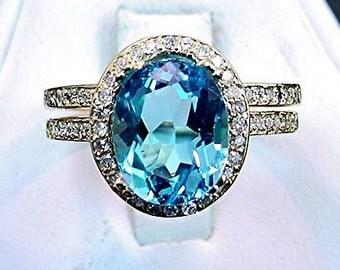 AAA Swiss blue Topaz   10x8mm  3.50 Carats   14K Yellow gold diamond Halo bridal set(.48ct)  B108