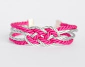 Bright hot pink and metallic silver double infinity knot nautical rope bracelet with silver anchor charm