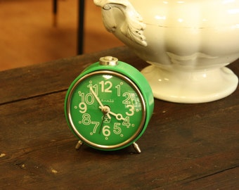 Green alarm clock from Soviet Union mechanical