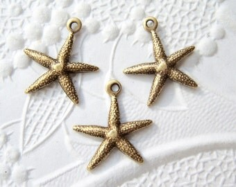 3 - Small antiqued  brass starfish charms -  TW150